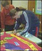 Children work on banner