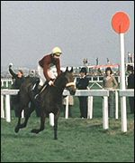Red Rum carries 12st to victory in 1974