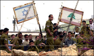 Israeli soldiers look into southern Lebanon