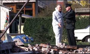 Scene of bomb is examined by forensic experts