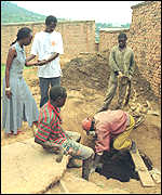 Relatives watch digging