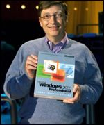 bill gates holds a windows 2000 package