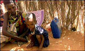 An Ethiopian woman comforts her severely malnourished child at Gode feeding centre