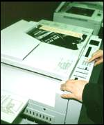 person using photocopier