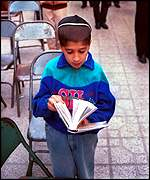 A young Jewish boy prays in Shiraz