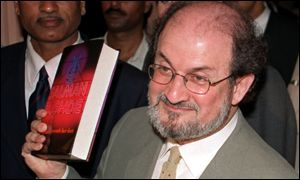 Rushdie with a book