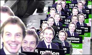 A crocodile of campaigners behind the Blair cut-outs
