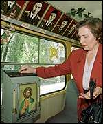 Woman making donation on tram