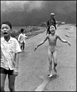 Children flee a napalm attack