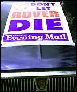 'Don't let Rover die' poster on Rover car outside the Longbridge car factory