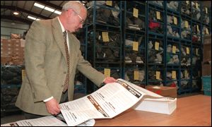 Returning officer John Cowdal examines the ballot papers