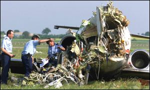 French police examine the wreckage at Lyon-Satolas Airport