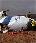 Police search the cockpit of PanAm flight 103 for clues