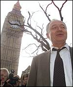 Ken Livingstone by Houses of Parliament