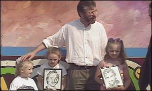 Sinn Fein President Gerry Adams with children holding memorial pictures of hunger stirkers