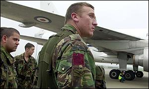 Paratroopers prepare to board planes at RAF Brize Norton