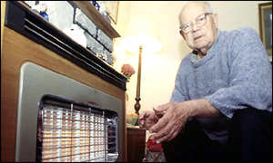 Pensioner at gas fire