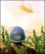 UN soldier and helicopter