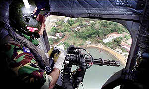 Gunner in helicopter.