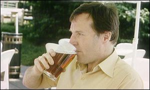 Quaffing pint of beer in pub garden