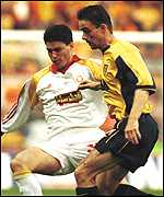 Overmars and Capone fight for control