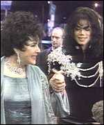 With friend, Michael Jackson at Aids event in 1997