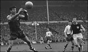 1964: Preston's 17-year-old Howard Kendall looks on as Goalkeeper Kelly saves a West Ham shot. West Ham went on to win 3-2.