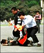 Police arrest a Falun Gong follower