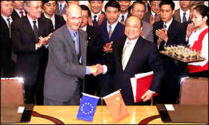 The EU's Pascal Lamy and and China's Shi Guangsheng shake hands on the trade deal
