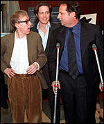 Woody Allen with Hugh Grant and co-star Jon Lovitz