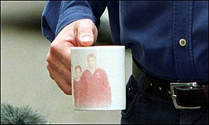 Tony Blair clasping a mug etched with a picture of his three older children, Kathryn, Euan and Nicky [Credit: BBC]