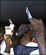 Voters hold cards