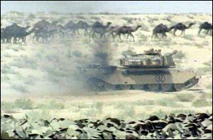 tank and camels in desert