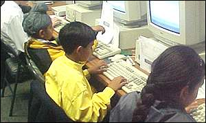 pupils using computers duing practical IT lesson