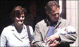 Cherie, Tony and Leo Blair step through the door of No. 10