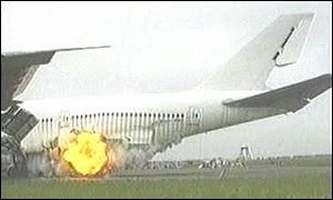 A bomb blows a hole in the fuselage of a jumbo jet