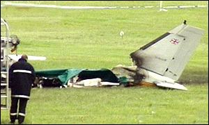 The burnt wreckage of the plane in which two jockeys were injured and the pilot died
