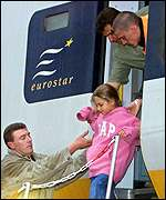 Girl being helped off train