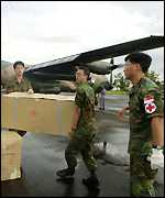 Singapore Army medical personnel unload relief supplies