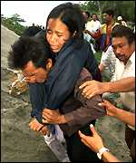 Injured woman being carried up hill
