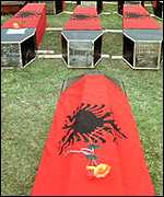 Coffins draped with Albanian flags