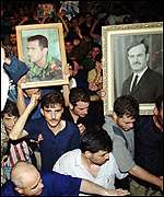 Mourners carrying Bashar's picture
