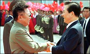 The two Korean leaders shake hands at Pyongyang airport