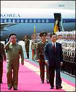 The two leaders walk down the red carpet at Pyongyang
