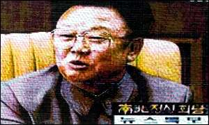 Kim Jong-il on TV screen