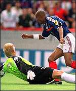 Peter Schmeichel and Nicolas Anelka