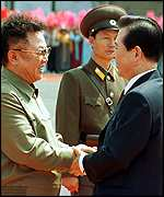 Kim Jong-il and  Kim Dae-jung shaking hands