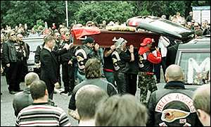 Hell's Angels place the coffin of their founder member Ian