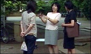 A Soka Gakkai member (centre) woos potential voters in a Tokyo park
