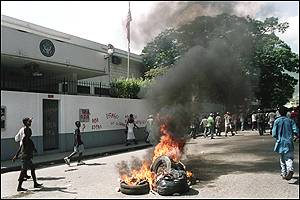 Tyres on fire outside the US embassy